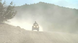 Four Wheeler On Dusty Road