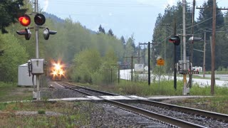 Freight Train Crossing Side Road in British Columbia