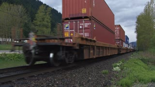 Freight Train Passing Through Mountains in British Columbia