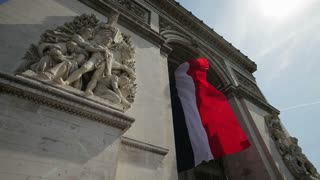 French flag under Arc de Triomphe built by Napoleon, Etiole, Paris, France, Europe