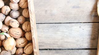 fresh walnuts in a wooden box