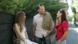 Friends talk facing city