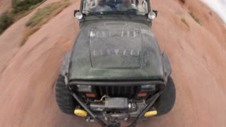 Front angle of green jeep driving 11