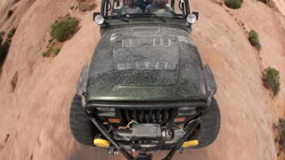 Front angle of green jeep driving 12