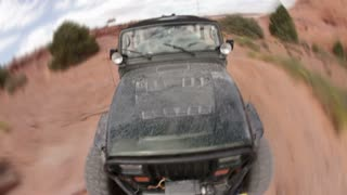 Front angle of green jeep driving 14