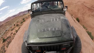 Front angle of green jeep driving 16