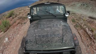 Front angle of green jeep driving 1