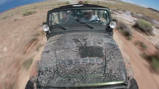 Front angle of green jeep driving 2