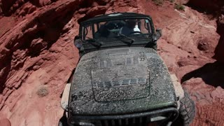Front angle of green jeep driving 4