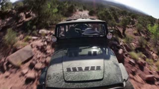 Front angle of green jeep driving 6