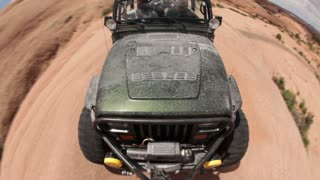 Front angle of green jeep driving 9