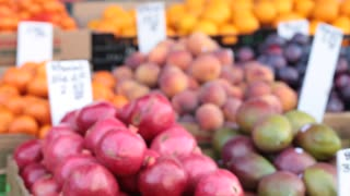 Fruits for sale at fruit stand rack focus