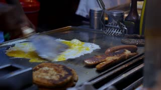 Fry Eggs and Fast Food Hamburger Meat on Street