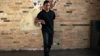 Full Body Shot of Young Man Hip Hop Dancing in Slow Motion