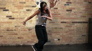 Full Body Shot of Young Woman Hip Hop Dancing in Slow Motion