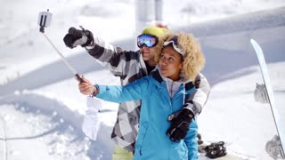 Fun young couple posing in the snow for a selfie
