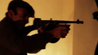 Gangster Fires Tommy Gun Down Hallway