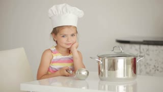 Girl cook with a saucepan and ladle