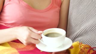 Girl drinking coffee and smiling. close-up
