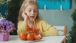 Girl drinking tomato juice and laughing at camera. Thumb up. Ok. Zooming