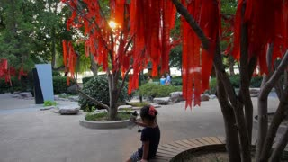 Girl Drinks Water under Najing Wishing Tree