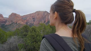 Girl Hiker Admiring Utah Mountain from Lookout Point