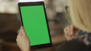 Girl Holding Tablet with Green Screen