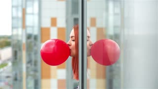 Girl Inflates A Red Bubble Gum