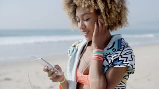 Girl Listening To The Music From A Smart Phone
