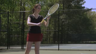 Girl Makes Tennis Serve