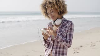 Girl On Beach Listening To Music