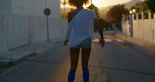 Girl On Roller Skates at Sunset