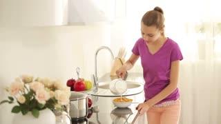 Girl preparing their own breakfast