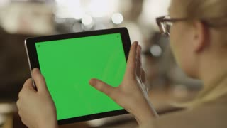 Girl Using Tablet with Green Screen in Landscape Mode.