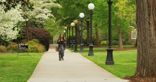 Girl Walking On University Campus