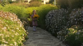 Girl with flowers walking in the park