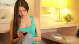 Girl with phone sending message