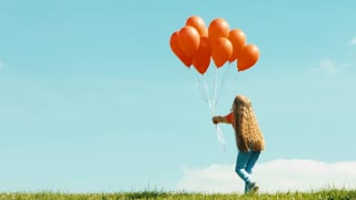 Girl with red balloons against the sky and waving hand. Zooming