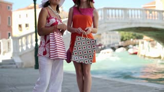 Girlfriends by Canal bridge shopping