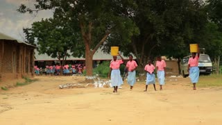 Girls Carrying Buckets of Water on Heads