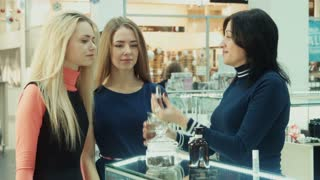 Girls chooses perfume in mall