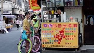 Girls With Bikes at Drink Stand in Shanghai