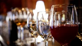 Glasses with alcohol and different drinks - wine, champagne on banquet table in a restaurant