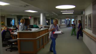 Gliding Shot Of Busy Nurses And Hospital Shot