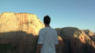 Gliding Shot Of Man Taking In Mountain View