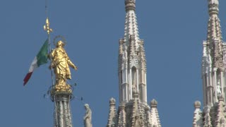 Golden Statue with Italian Flag on Duomo