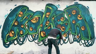Graffiti artist drawing on the wall, timelapse