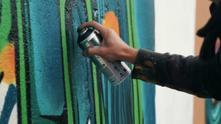 Graffiti artist drawing on the wall