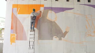 graffiti artist painting on the wall