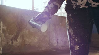 graffiti artist spraying can in ghetto